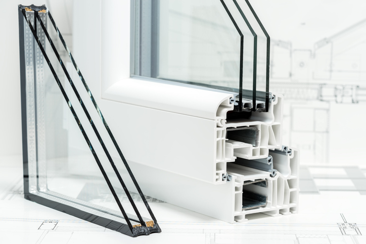 A cross section of window Design of pvc profiles for window, triple glazing cross selection, technical drawing on background.