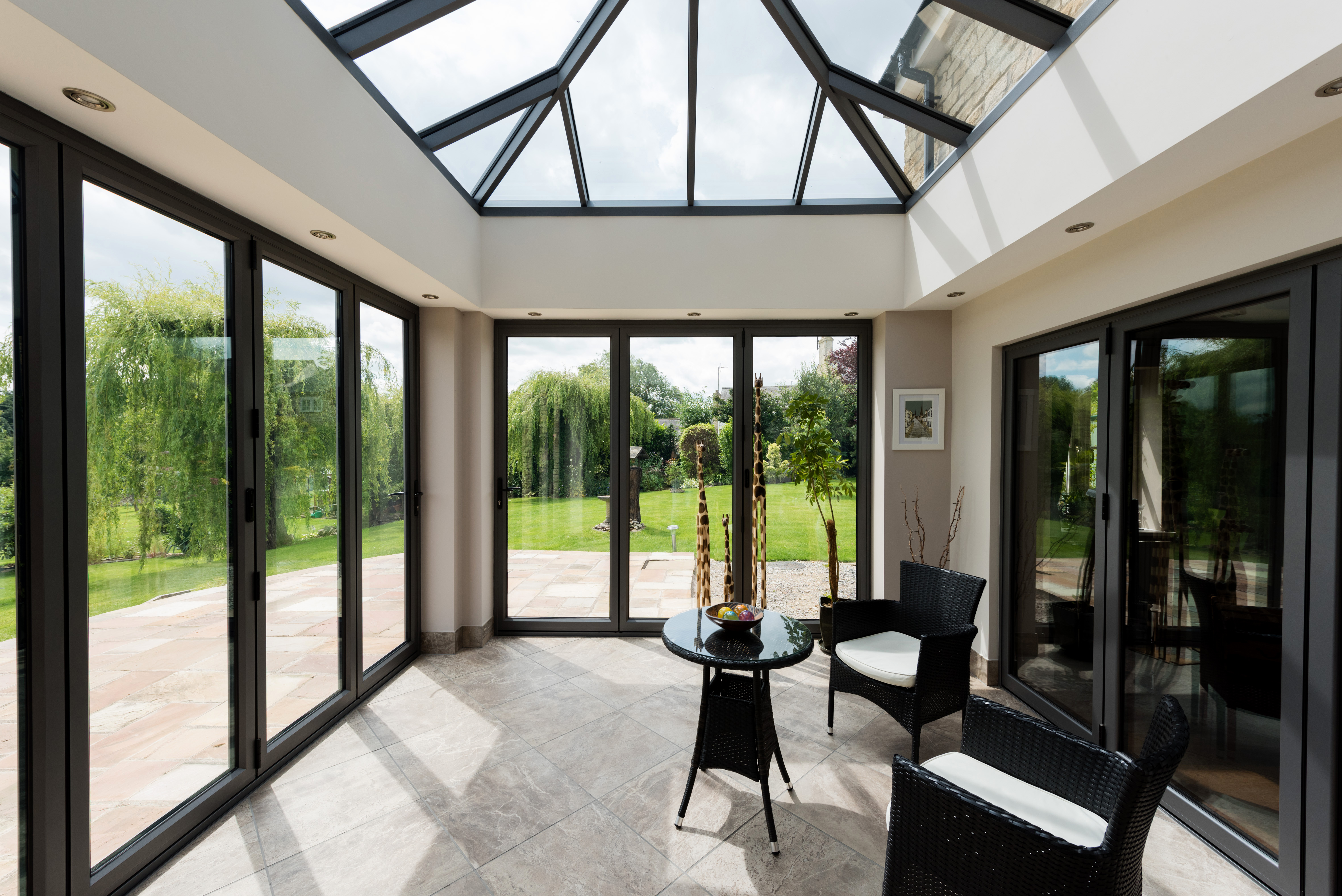 new conservatory design and solid roof extension by 21st Century Conservatories & Fascias