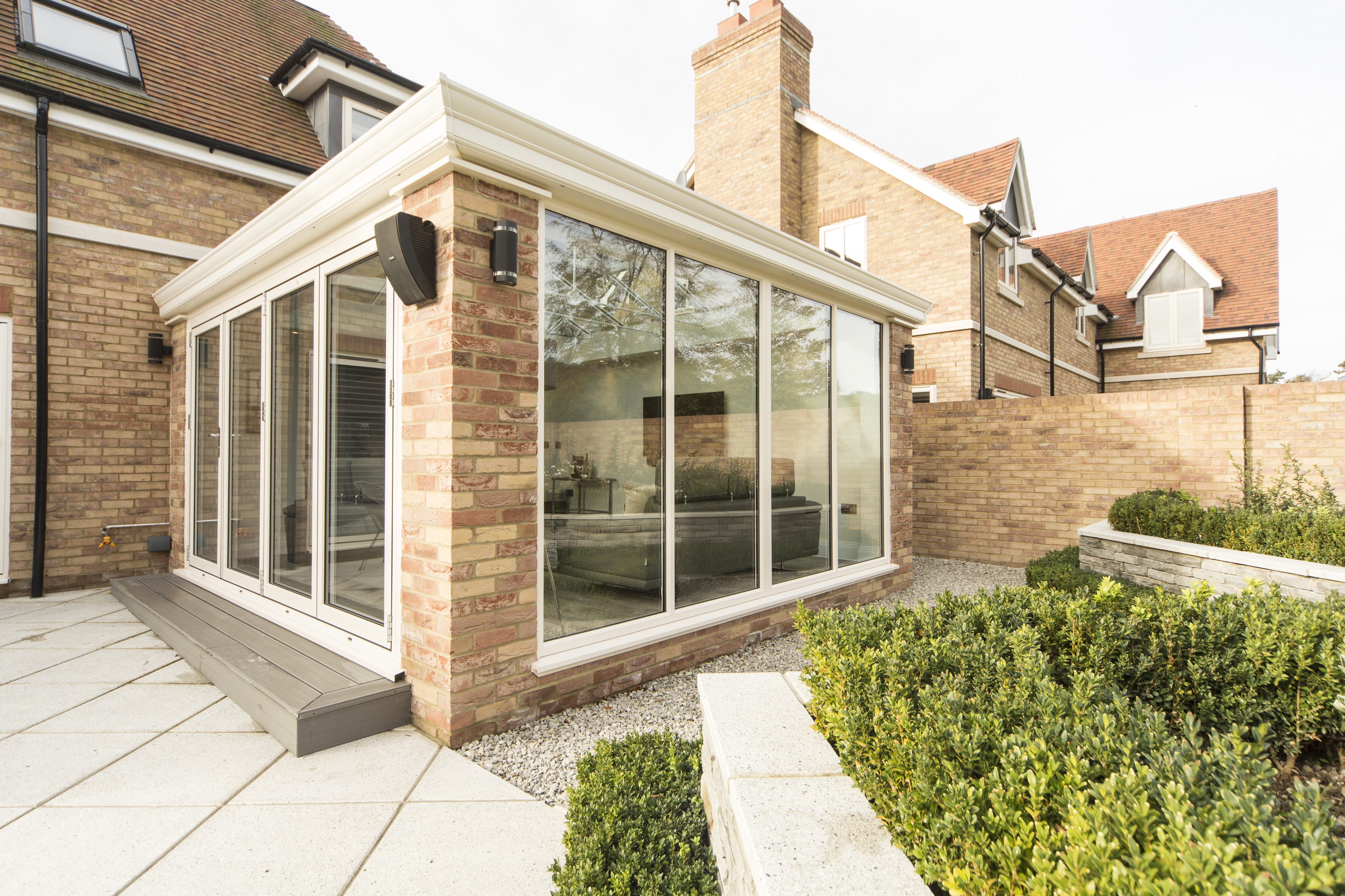 Front view of a 21st Century new conservatory installation with new french doors.