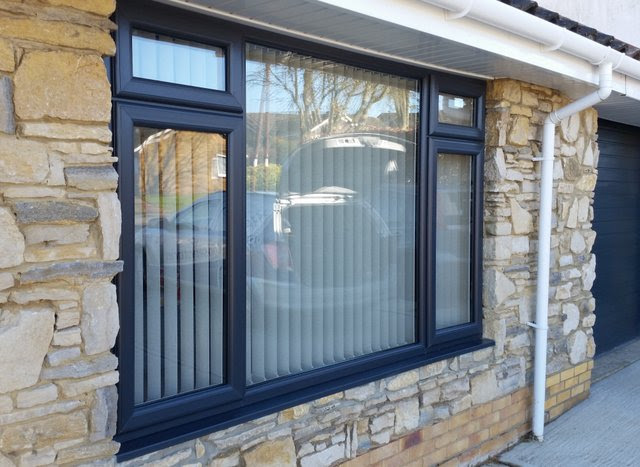 Wide black PWC window by 21st Century conservatories and fascias.
