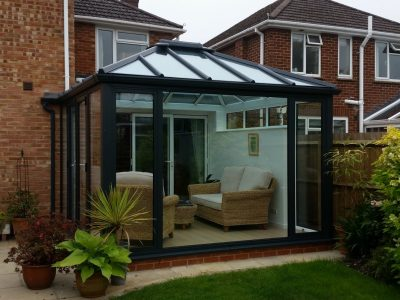 Outside view of a cosy Livin room conservatory design ideal for reading.