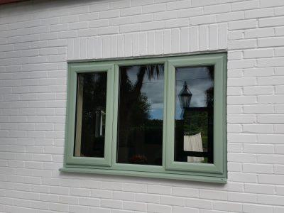 Pastel green new PVC window