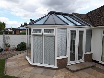 New Livin room conservatory with built-in blinds to stop the light coming through.