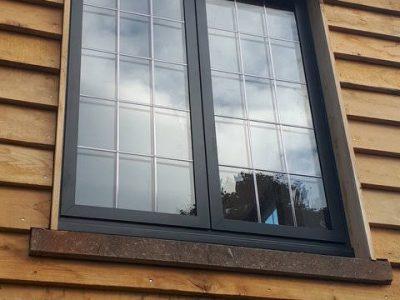 Low angle image of new black aluminium windows.