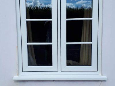 White heritage window design installation.