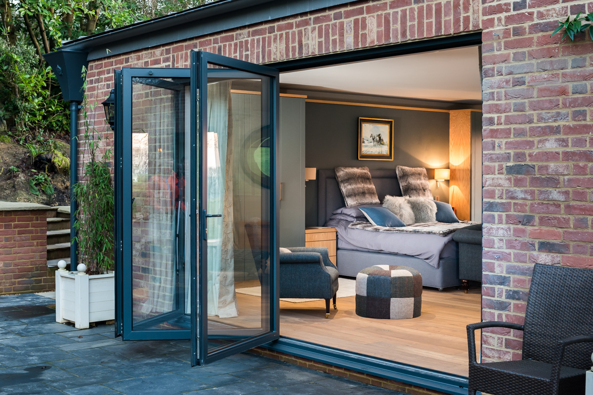 Luxurious new french doors and patio with Aluminium Bi-Fold.