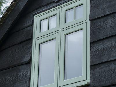 Beautiful pastel green heritage window design.