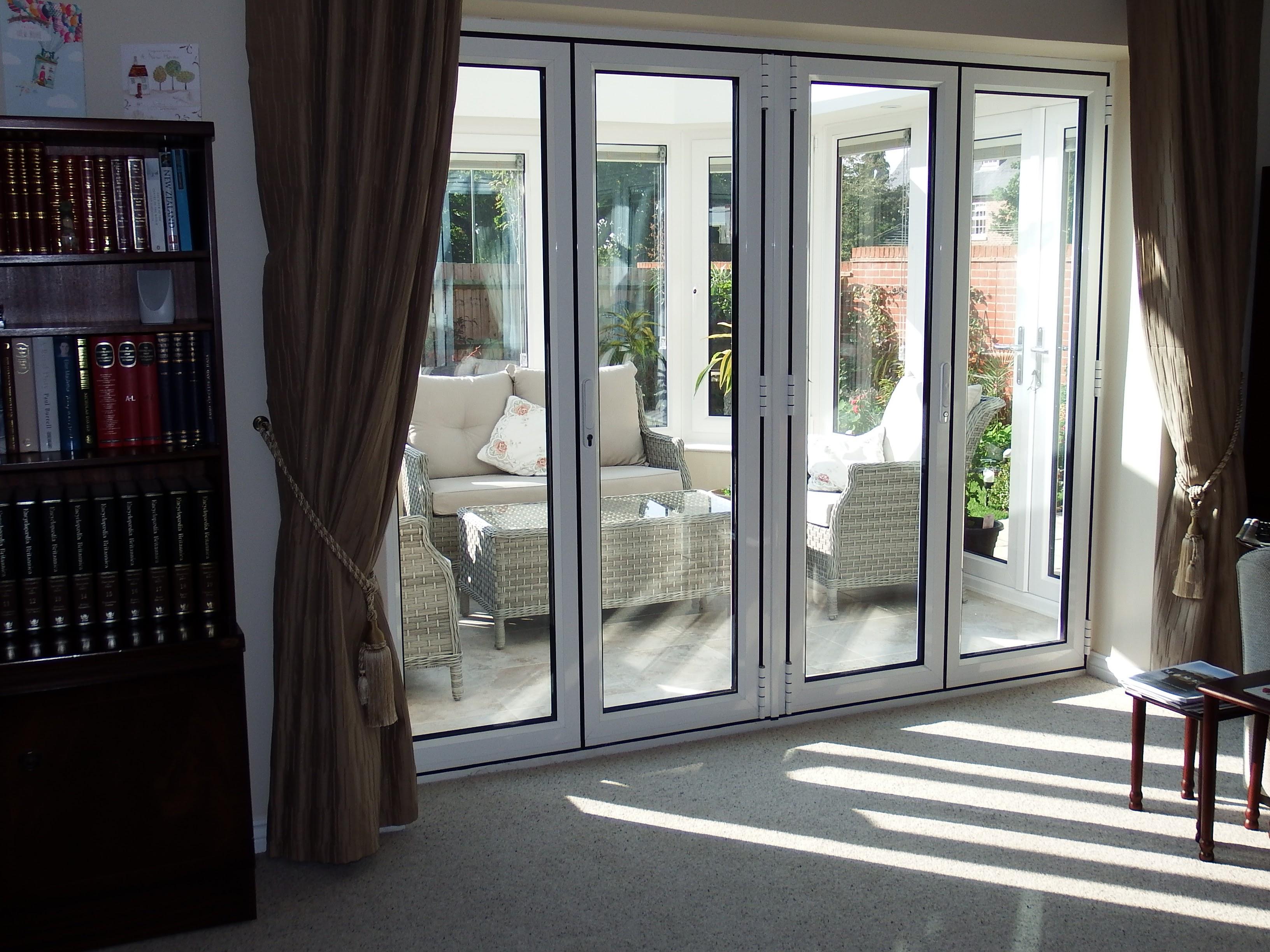 Bright & new french doors with Aluminium Bi-Fold.