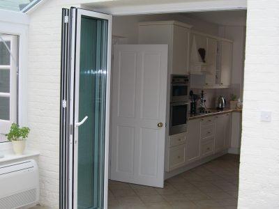 Aluminium Bi-Fold french doors installation.