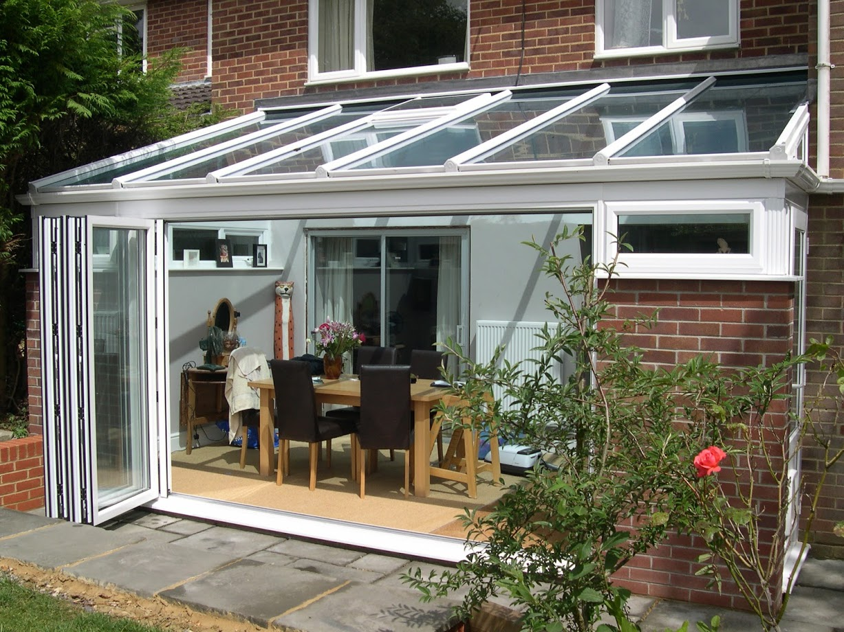New conservatory design with practical sliding french doors.