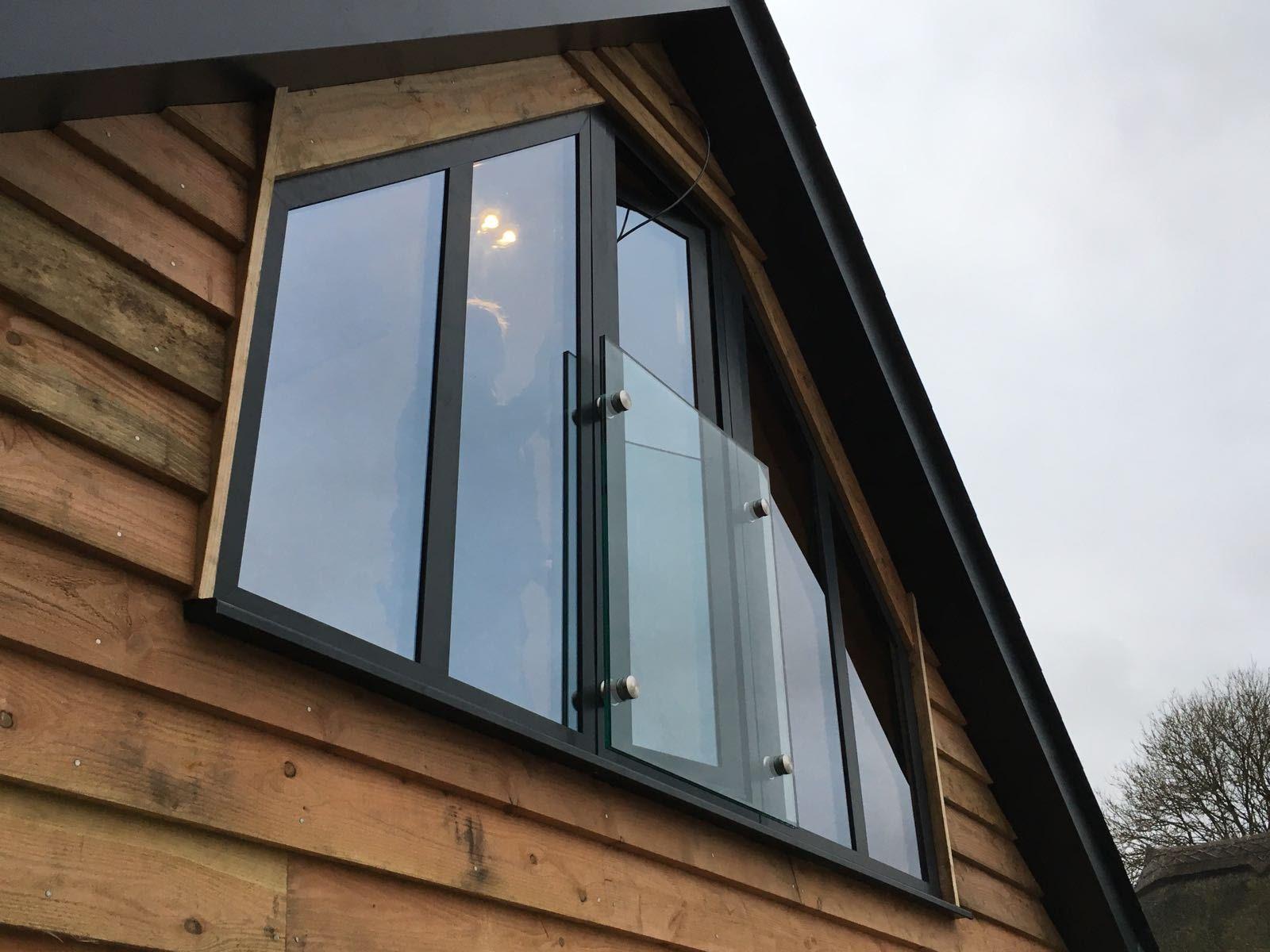 Lovely shaped aluminium windows created by 21st Century.