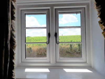 Simple white heritage window with picturesque views.