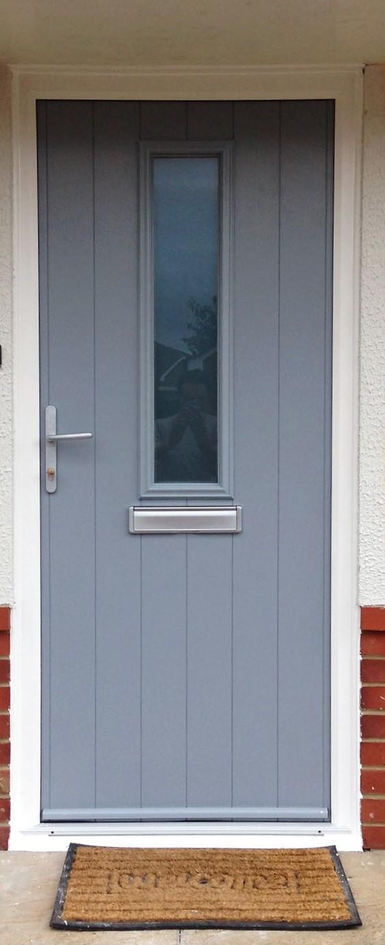 Light grey composite door installation.