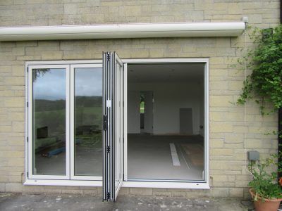 New french doors with Aluminium Bi-Fold leading onto a new patio.