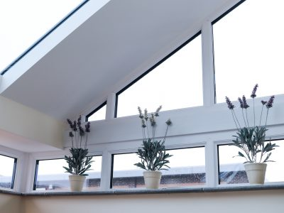 Image of flower pots on top of new window installation.