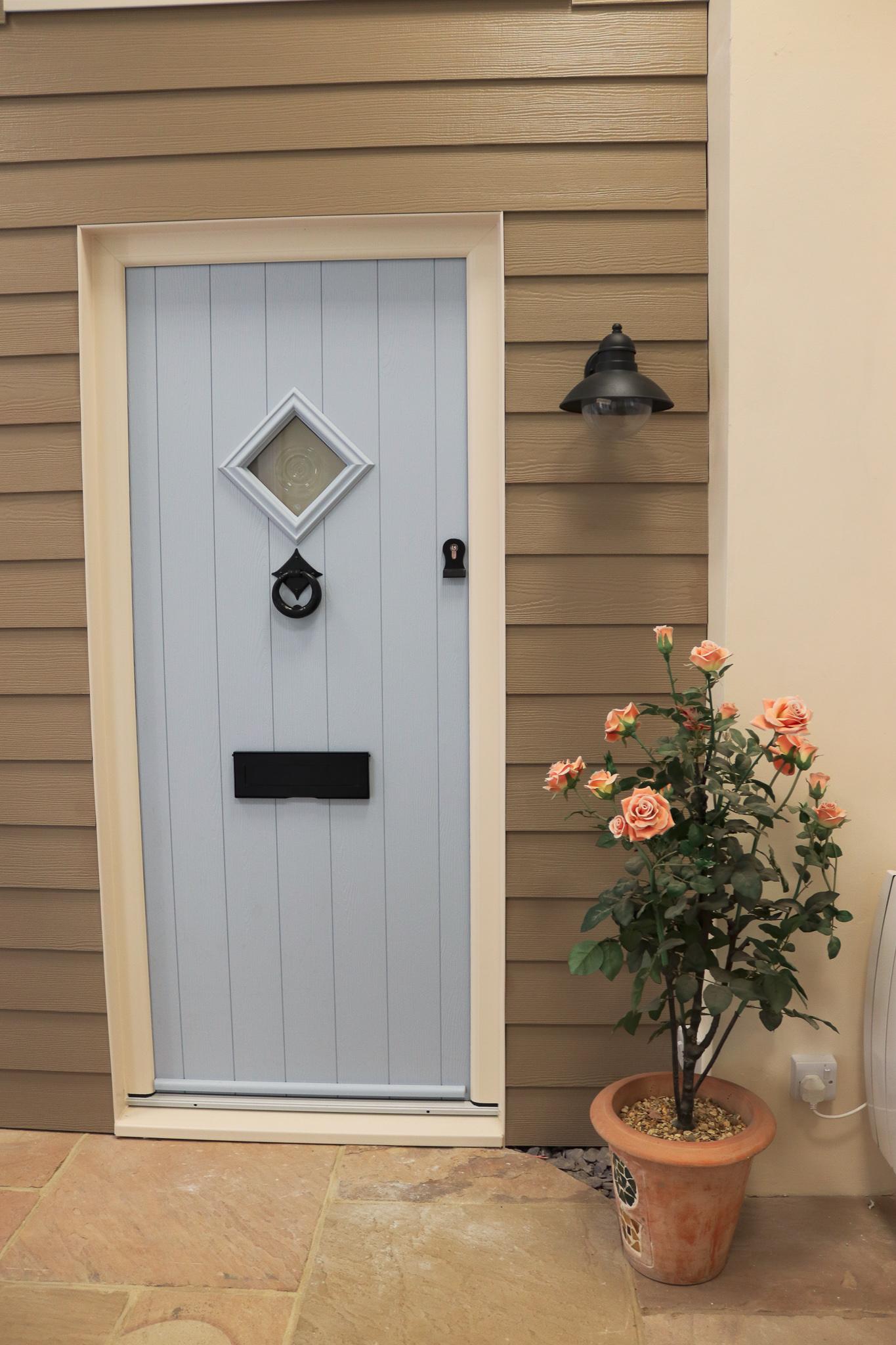 White front door installation.
