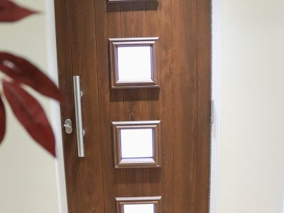 Image of wooden front door.