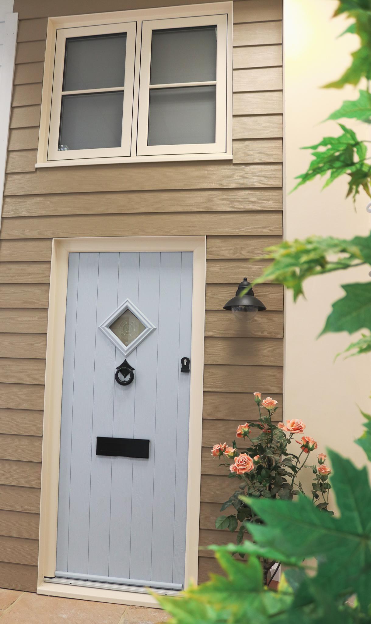 Light grey front door design.