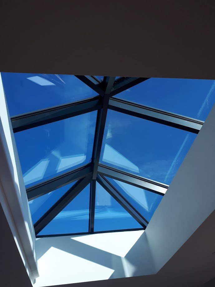 Low angle image of a skylight from inside a conservatory.