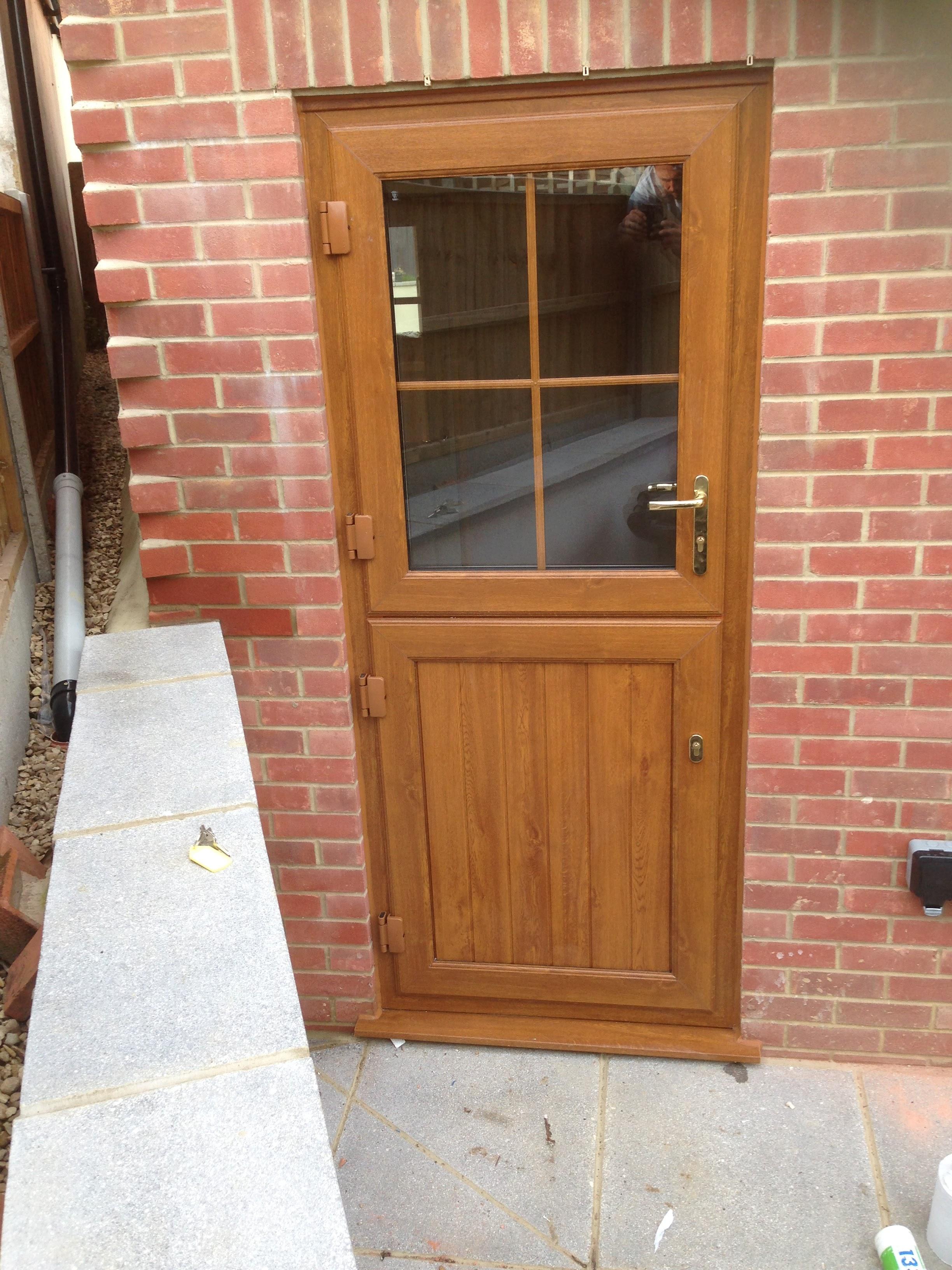 Warm and woody new PVC front door