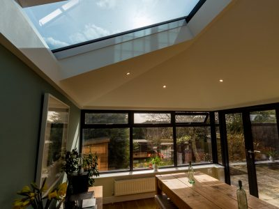 Radiant and roomy example of a conservatory and skylight design.