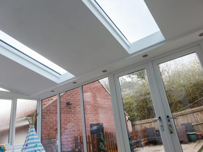 Image of 21st Century skylight designs and new french door installation.