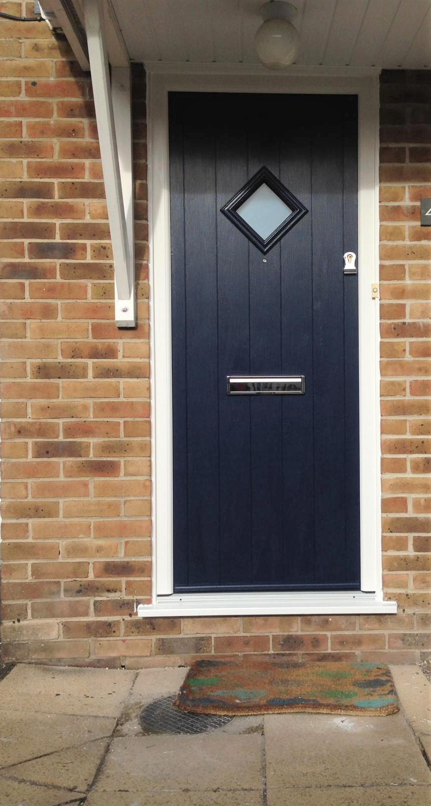 Front view of a dark blue composite door example.