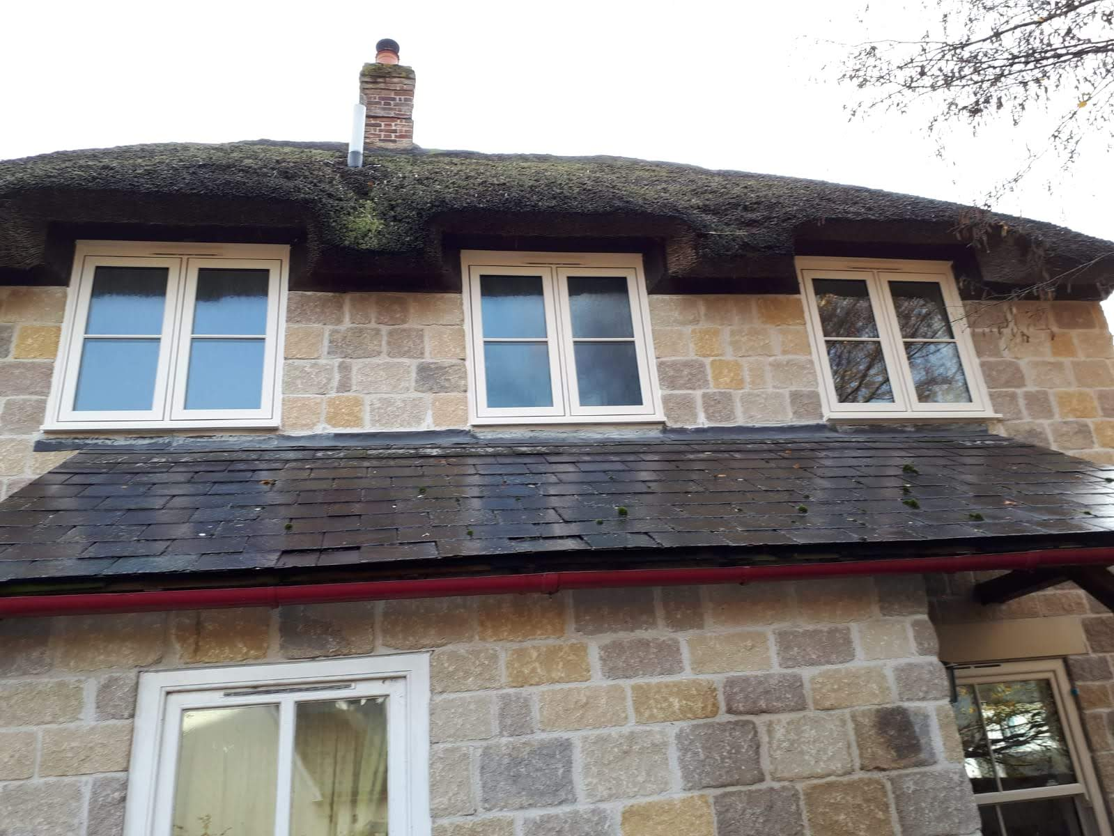 Cosy cottage with heritage window installation.