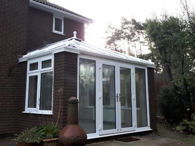 Brand new french doors and Livin room conservatory.