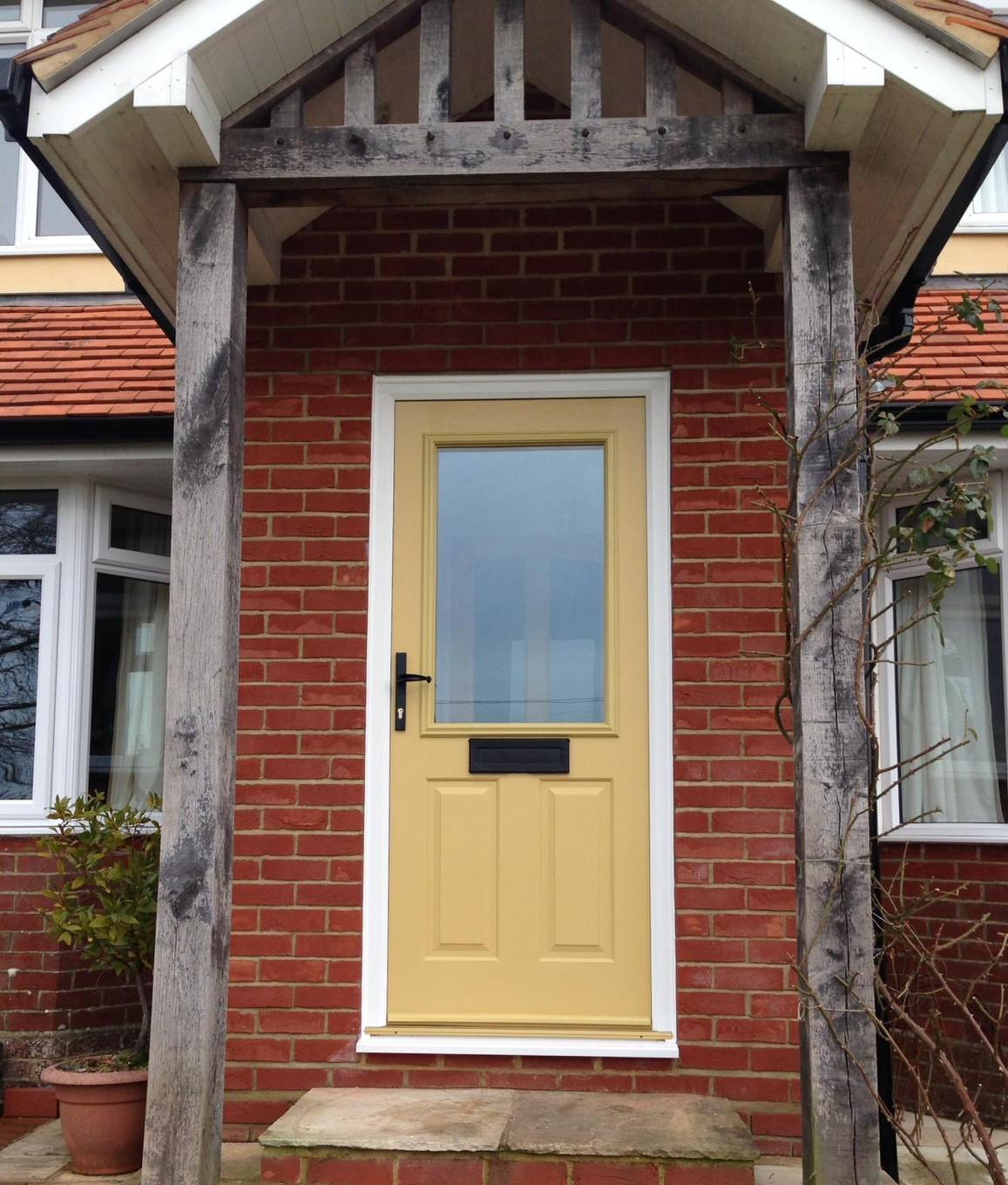 Bright yellow composite door design by 21st century.