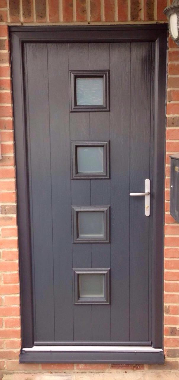 Grey modern composite door installation.