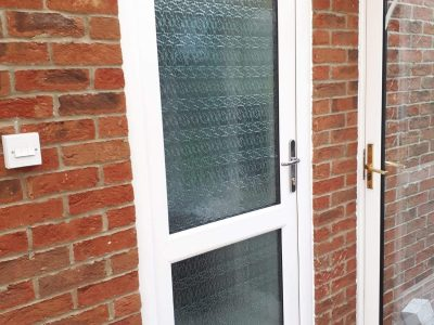 New PVC front door with glass.