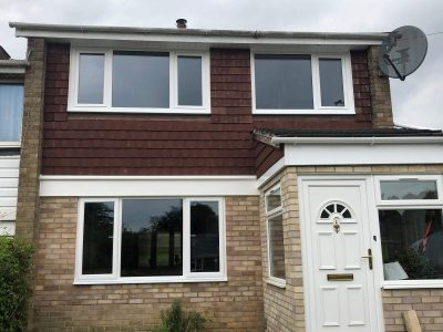 Front image of new, white PVC windows