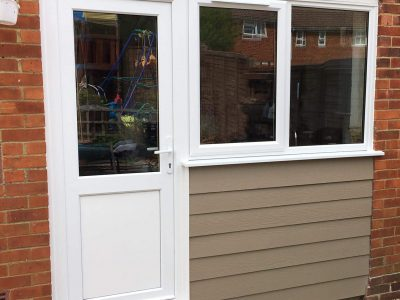 Side view of a new door installation for garden.