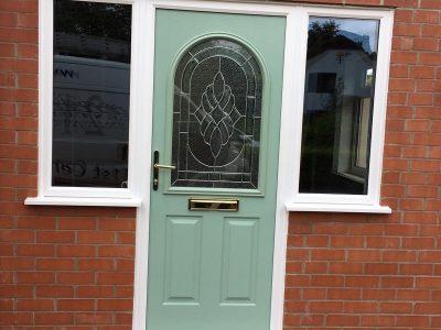 Lovely green new front door design.