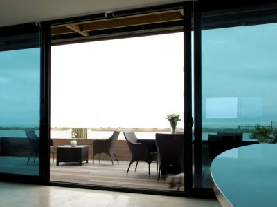 Brand new patio design with sliding french doors.