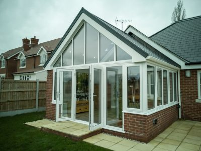 Front perspective of a lovely conservatory design created by 21st Century.