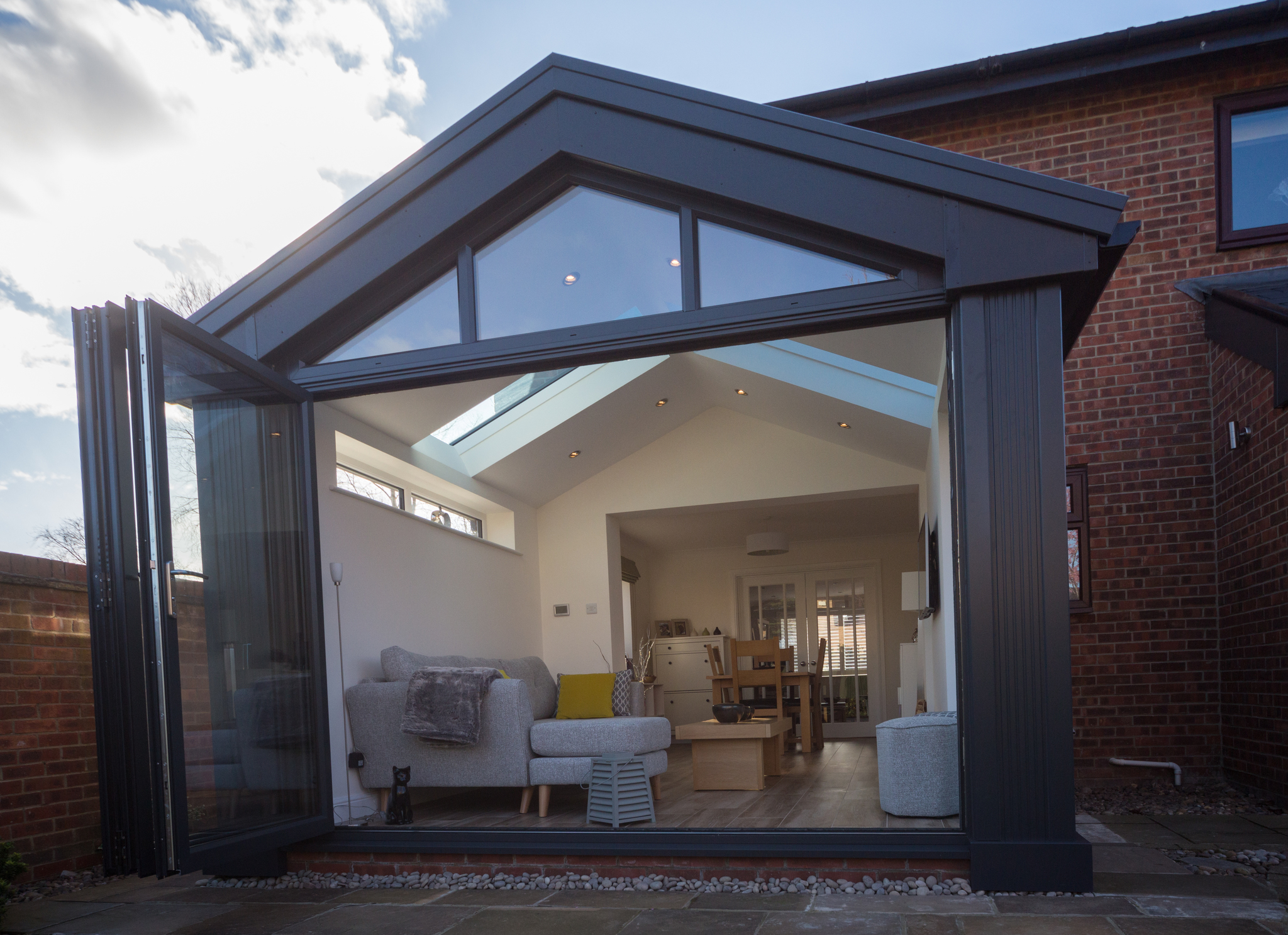 Example of a new conservatory installation with new bifold doors from 21st Century Conservatories & Fascias